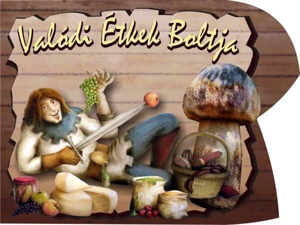 Valódi ételek boltja reklámtáblája: egy udvari bohóz (harlequin) friss zöldségek, sajtok, gomba közt hever és csemegézik belőlük.